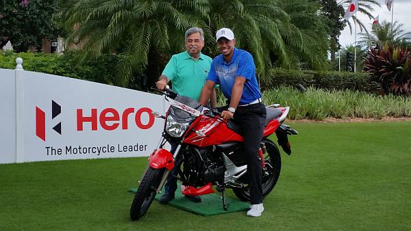 Tiger Woods and Pawan Munjal