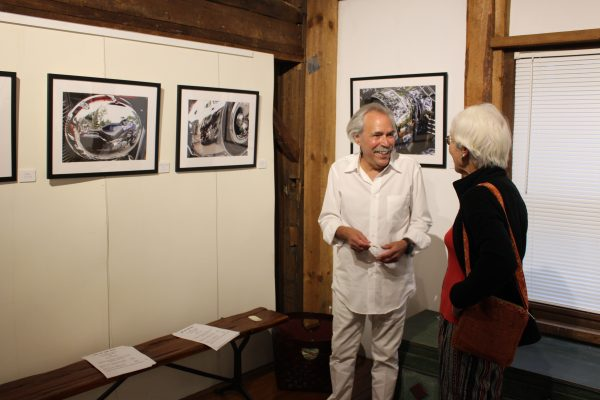 Gary Halby chats with a gallery visitor